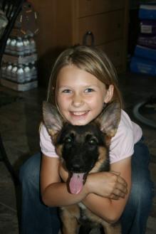 Girl with Cassie puppy